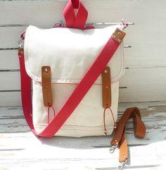 Canvas bag that's multifunctional. Messenger - backpack - school - travel - laptop bag! WANT!