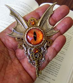 Suitably masculine, this dragon's eye looks right back at you. Add a steampunk broach to your coat lapel for a great costume accessory.