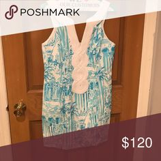 Lilly Pulitzer turquoise print dress Resort style at its finest! This Lilly dress flatters figure, and it's beautiful color will surely help you stand out! Lilly Pulitzer Dresses