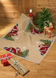 Sleeping Santa Christmas Tree Skirt - cross stitch kit by Permin of Copenhagen - Santa sound asleep in the snow watched by a little white rabbit.