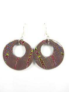 These handmade polymer clay round disk earrings feature shimmering shades of purple, magenta, lime green and grey in a eye-catching hypnotic design. The backside is solid black and both front and back are coated in water based glossy varnish. https://www.etsy.com/listing/152350999/polymer-clay-earrings-purple-pink-lime