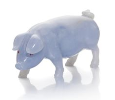 A HARDSTONE PIGLET. carved of blue chalcedony, cabochon ruby-set eyes