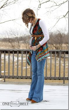 maternity style- ONE little MOMMA. ethnic vest, flare jeans, white tee, belt.