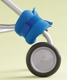 Ankle weight on a stroller wheel to keep umbrella strollers from flipping over when child is removed.