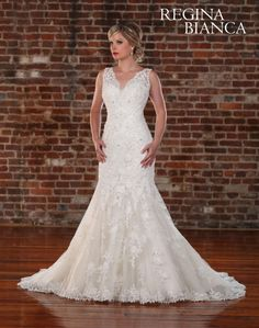 Regina Bianca  Style #RB1004  Alluring V neck tank top sheath bridal fashion is made of all over venise lace on net over satin. The trumpeting skirt is adorned with beaded lace appliques including the hem. There is beautiful scoop back, with a chapel train.