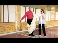 How to Wear a Toga the Ancient Roman Way - YouTube  (Last part of this shows how to do this with a sheet....you might want to skip to that if yout want to figure it out fast).