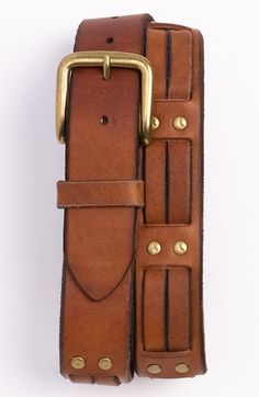 1981 'Double Laced' rived studded leather belt by Bill Adler. Narrow straps thread through a rivet-studded leather belt with unfinished edges for an edgy, rough-hewn look.