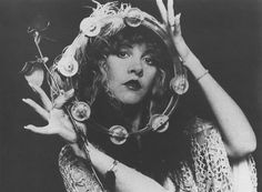 """Stevie Nicks looks like a druid queen or the girlfriend of a guy with a fully customized van— but fortunately she's neither. The 66 year-old legend who got her start as as the singer-songwriter in Fleetwood Mac back in the 70's was as famous for her raspy renditions of """"Rihanna"""" and """"Silver Springs"""" as she was for her Flapper meets Goth chick meets Topanga Canyon fashion— silk stockings, fingerless gloves, lace-up boots, and shawls, shawls, shawls."""