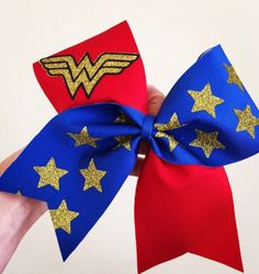 Wonder Woman tick tock Deluxe spandex Cheer Bow Gold glitter accents by TalkToTheBow on Etsy (null) Wonder Woman Birthday, Wonder Woman Party, Wonder Woman Comic, Wonder Women, Cute Cheer Bows, Cheer Mom, Cheer Stuff, Diy Bow, 6th Birthday Parties
