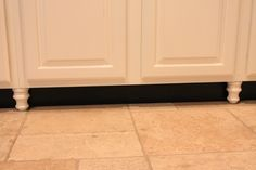 Great way to improve builders cabinets..paint toe kick black and add feet/legs  http://www.storiesofahouse.com/wp-content/uploads/2012/10/IMG_7858.jpg