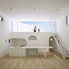 Light stage house, by architect Bunzo Ogawa in Hiroshima Japan. Clean whites throughout this house, open space & most of all SUN DECK!