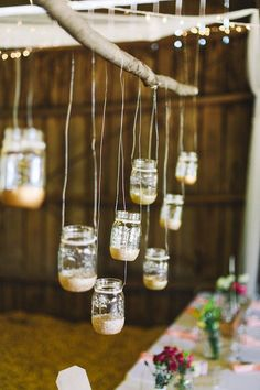 Hanging mason jars dipped in gold glitter DIY / Brett and Jessica Photography