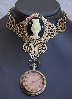 holy hell I've just died and gone to heaven. An Edger Allen Poe steampunk watch necklace!! It's like crack!