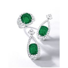 Fine Pair of Emerald and Diamond Pendant Earrings and Ring. The earrings each with a cushion-shaped emerald weighing either 5.46 or 4.71 carats, to a pear-shaped frame set with 4.75 carats of diamonds, in 18 karat white gold; the ring with a 10.02 carat cushion-shaped emerald flanked by 3.70 carats of half-moon and brilliant-cut diamonds, mounted in platinum.