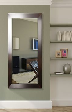 Features:  -Vertical and horizontal hanging hardware included.  -Jovie Jane collection.  -Material: Beveled glass.  -Frame material: Wood component.  -Frame finish: Silver.  -Full length tall size can