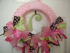 baby girl ribbon wreath in tulle with brown, yellow, pinks and greens