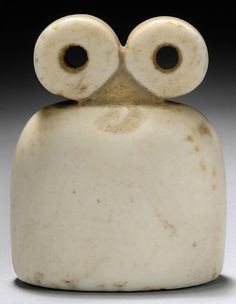 A SYRIAN WHITE STONE SPECTACLE IDOL   TELL BRAK, CIRCA 4TH MILLENNIUM B.C.   With bell-shaped body surmounted by two circular perforated 'eyes'   2 1/8 in. (5.3 cm.) high