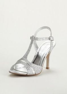 """This T strap mesh heel offers comfort and fashion and all the sparkle you could ask for!  Sandal features a T-strap, sparkle, and mesh detail.  Heel height measures 3 1/2"""".  Available in Silver Metallic and Gold Metallic.  Imported."""