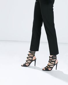 ZARA - COLLECTION SS15 - Black leather high heel gladiator sandals.