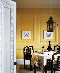 Chinoiserie dining room: pagoda pendant light, handsome chairs, door and panel detail