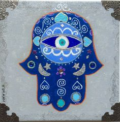Beautiful painting of a blue Hamsa hand or the hand of Fatima on a gray background. Painted with acrylic paints and decorated with embellishments and silver metal corners. One of a kind piece. Hamsa is a popular charm, originally from the Middle East and North Africa. It is used as a sign of protection against the evil eye and as a symbol of good luck. Sides are painted gray. Signed. No framing needed. Sawtooth hanger in back. Ready for hanging.