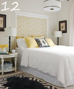 Fabric on wall and framed out with moulding to create a headboard