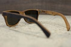 Wooden sunglasses made from whiskey-aging barrels