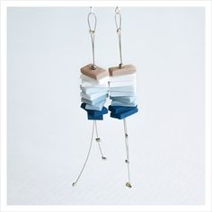 Minimalist earrings with geometric shape stacked by Doeksisters, $20.00