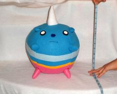 This is TV from adventure time. It's about 14 inches tall, very huggable , cuddly , and soft :D the circumference is 34 inches >.<  The plushie is super big and soft , made with soft fleece, and made with love