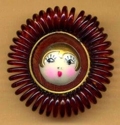 A wide-eyed flapper graces this celluloid button with a coil edge. This makes me want to dance the Charleston! www.mamasmiracle.com