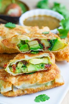 FOR THE EGG ROLLS: 2 large avocados, diced 4 sundried tomatoes packed in oil, sliced 1/4 cup red onion, diced 1/2 jalapeno, finely diced 1 tablespoon cilantro, chopped 1 tablespoon lime juice (~1/2 lime) 8 egg rolls 1 egg white
