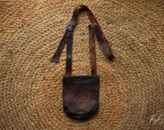 """Southern Appalachian Mountain """"Black Powder Shot Pouch""""  This is 100% handmade using authentic materials and craftsmanship. Bark tanned buck skin fabric with an interior pocket. Cast pewter button with four adjustable lengths. Sewn with genuine bees waxed Irish linen thread. Seams are welted.   This bag is tough. To maintain optimal condition of the un-treated leather it is recommended to keep conditioned with oil and/or wax."""