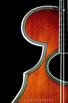 mandolin...a stringed instrument and a member of the lute family.  Having eight strings in four courses, frequently tuned as a violin.