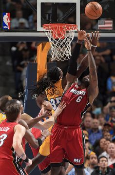 Kenneth Faried #35 of the Denver Nuggets and LeBron James #6 of the Miami Heat battle for control of the ball at the Pepsi Center on November 15, 2012 in Denver, Colorado.