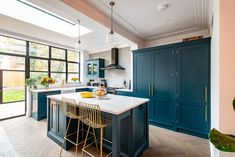 We recently designed and fitted this bespoke kitchen for a lovely couple in London. The cabinetry is painted in a colour similar to Hague Blue and finished with brass handles. Blue Kitchens, Kitchen Diner Extension, Beautiful Kitchens, Bespoke Kitchens, Ikea Food Storage, New Kitchen, Studio Kitchen, Hague Blue Kitchen, Kitchen Design