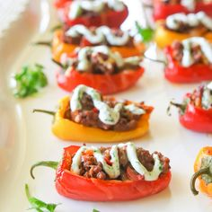 Mini Taco Stuffed Peppers Recipe Appetizers with ground beef, Old El Paso™ taco seasoning mix, water, sweet mini bells, cheese, sauce, sour cream, fresh cilantro, minced garlic, lime juice