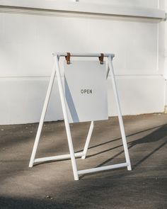 A simple and functional take on the traditional sandwich board, the Merchant Sign will help you stand out in your chosen streetscape.  Made from vegetable tan leather, aluminium and ready for your logo and details to be locally applied, the Merchant Sign will help perfectly display your cafe or store's ideas on the street, and bring people in.   Available in black or white. Signage Design, Cafe Design, Store Design, Shop Signage, Booth Design, Banner Design, A Frame Signs, Coffee Shop Design, Calathea