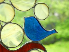 Stained Glass Suncatcher: Blue Bird in a Yellow Tree. $35.00, via Etsy.