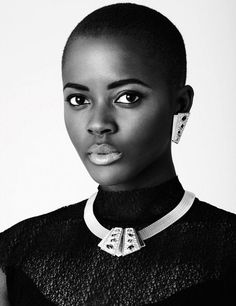 it's not the fake hair that makes a woman. black...bald and beautiful