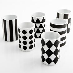 These would be super cute to make yourself. White cups and black paint!