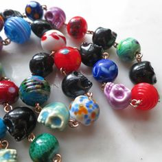 'Hippie Chick' necklace (detail) with ceramic skulls, lampwork beads & bronze  - Lucinda Storms : Belvedere beads