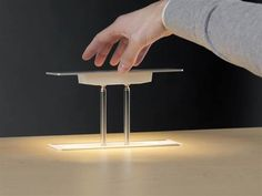 Levity desk lamp disappears into your desk