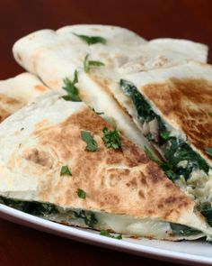 Servings: 2 quesadillasINGREDIENTS1 tablespoon olive oil½ cup mushrooms, sliced2 cloves garlic3 cups fresh spinachSalt, to tastePepper, to taste3 eggs2 large flour tortillas1 cup mozzarella, shredded (double for 2 quesadillas)½ cup parmesan, shredded (double for 2 quesadillas)GARNISHParsleySalsaPREPARATION1. Let the oil heat up in the skillet and add the garlic followed by the mushrooms. Cook until the mushrooms have softened and caramelized a bit.2. Add the spinach and cook until spinach…