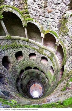 Quinta da Regaleira, or in english, The Inverted Tower - Sintra, Portugal    An underground tunnel with a spiral staircase.