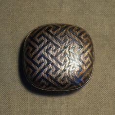 Title: a shibuichi Hako Netsuke, woven. ,unsigned, Meiji period, 19th century 3.4 x 3.2 cm, 1.6 cm high