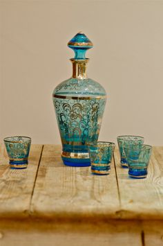DOUBLE WOOOOW WITH MY MOUTH WIDE OPEN! Vintage Blue Venetian glass decanter and four glasses with silver finish scenes and flower decoration.