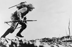 Okinawa, April - June 1945: An American Marine dashes for cover on Okinawa.