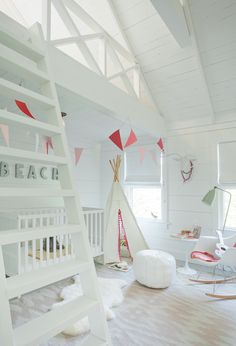Nursery loft with shiplap walls, ladder and teepee | Jenny Wolf Interiors