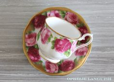Stunning shabby chic tea cup and saucer featuring a light and dark rose motif against a white background. Elegant gold trim and scalloped edges in the Hampton style. A must have for any shabby chic tea cup collector! Hampton Style, China Patterns, Old English, Cottage Chic, Drinkware, Cup And Saucer, Light In The Dark, The Hamptons, Tea Party