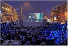 """Tromsø International Film Festival in Norway: """"January is dark and cold in Tromsø, so it's a perfect time to arrange the Tromsø International Film Festival. This is the outdoor cinema in the city square; the screen is made of snow and ice."""""""